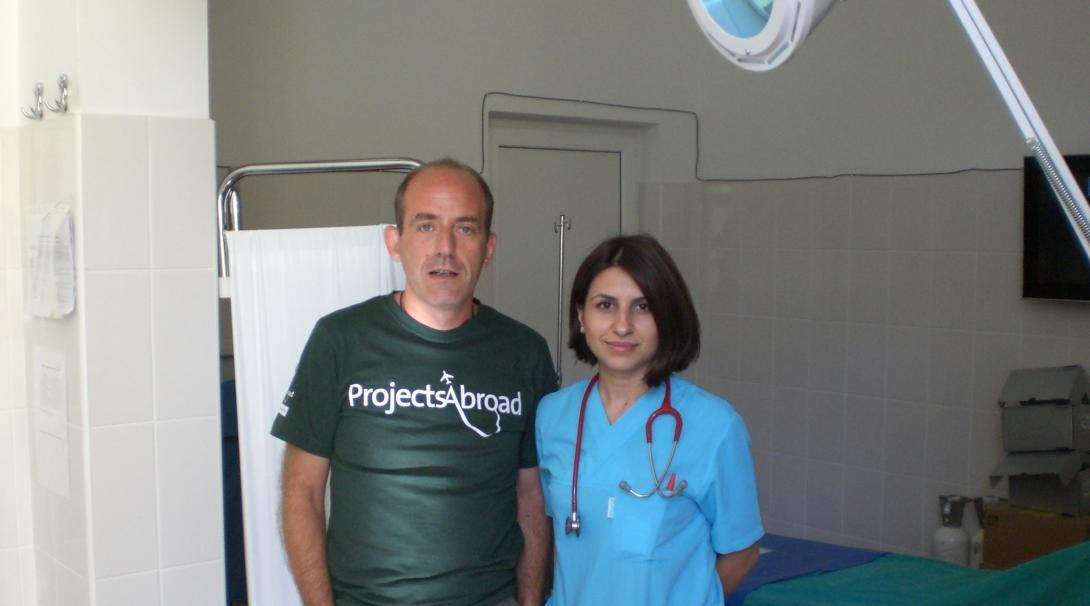 An Italian intern taking a picture with a local doctor after his medical internship in Romania gining work experience with Projects Abroad.